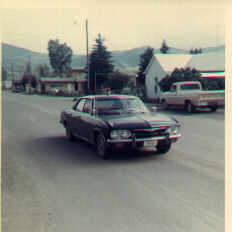 Image of the black four-door Corvair police car in Creede