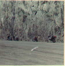 Image of our four bikes parked beside a rock wall on the road above Creede