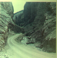Image of the crooked and steep road above Creede, curving between rugged hills and cliffs